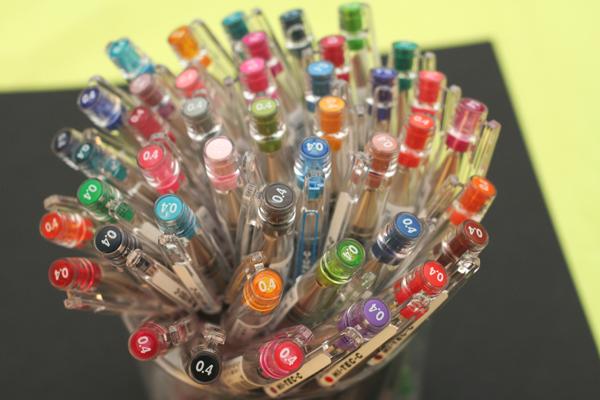 Pen holder filled with a colorful array of 0.4 mm Pilot Hi-Tec-C Gel Pens