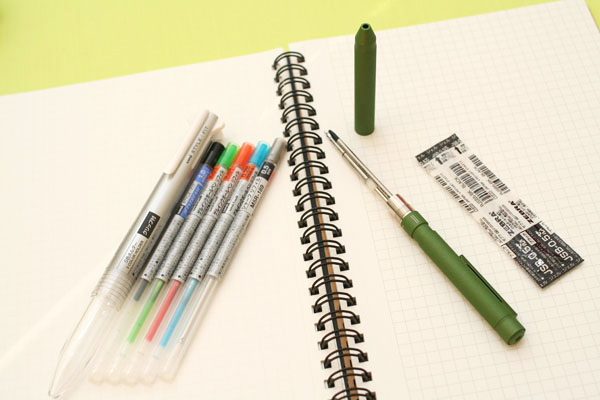 Shabo X Multi Pen System pen components spread out over a notebook page